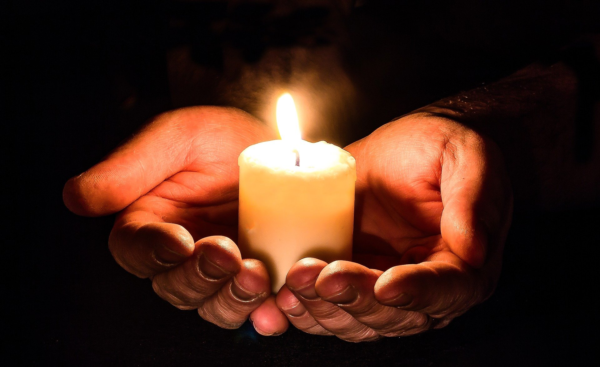 candle praying hands